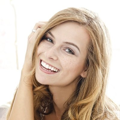 Cosmetic Dentistry Orlando - A woman smiles to show how Zoom! Teeth Whitening has brightened her smile