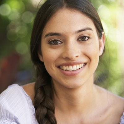 Cosmetic Dentistry Orlando - A woman smiles to show how dental veneers from our East Orlando dentist enhances your smile