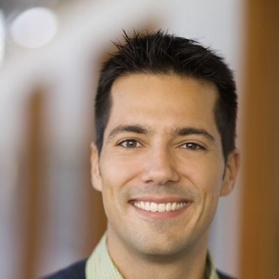 Smiling man who has healthy gums thanks to Orlando family dentistry