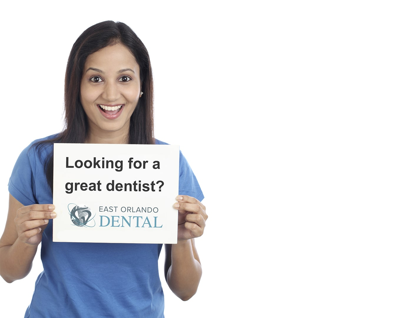 "Woman holding sign that says ""Looking for a great dentist?"""