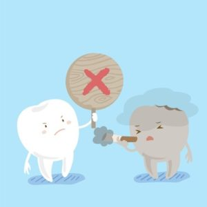 Two cartoon teeth with one smoking and the other holding a sign saying no