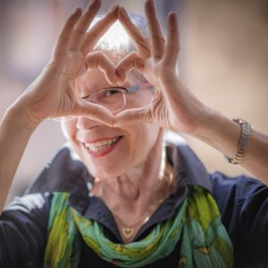 Older Woman Making Heart Shape with Hands